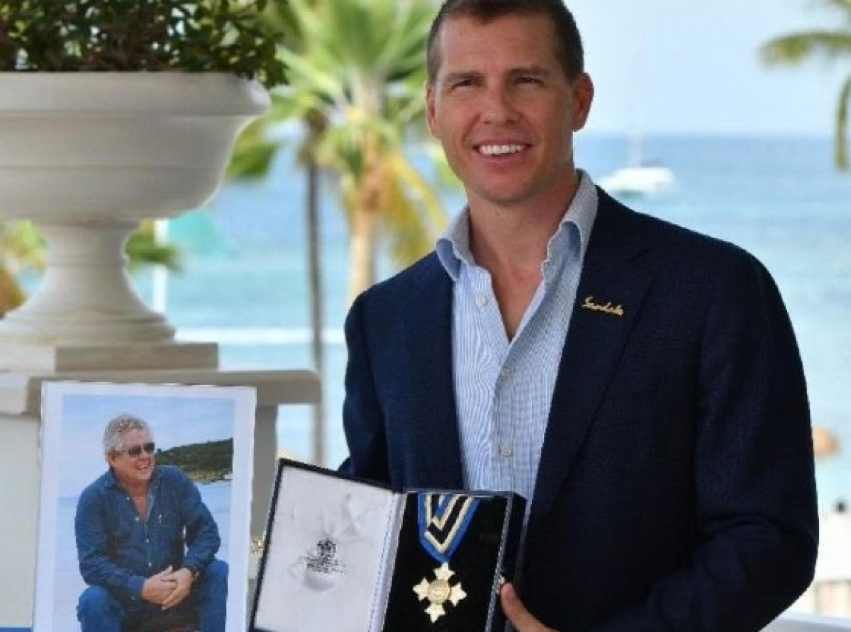 Adam Stewart, CD, Executive Chairman of Sandals Resorts International, accepting the Saint Lucia Cross Award on behalf of his late Father, Gordon 'Butch' Stewart.