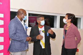 Minister of Tourism Hon. Edmund Bartlett (left) in conversation with British High Commissioner to Jamaica Asif Ahmad (centre) and Diane Corrie of British Airways following the return of British Airways service from London at the Sangster International Airport on Saturday