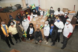 At Econo-Caribe Shipping warehouse in Queens, NY, members of UJAA brave the icy New York weather to deliver boxes of laptops and tablets for shipment to students in Jamaica. UJAA photo