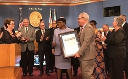 MIA Director Lester Sola accepts a proclamation from the County Commission on MIA's passenger traffic milestone.