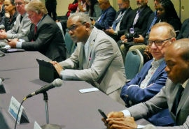 Governor Albert Bryan Jr. (center) listens attentively to cruise line executives in San Juan last week.