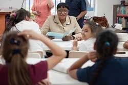 Chairwoman Audrey M. Edmonson reads to students at the Latinos United After-School Program in Allapattah. (Photos by Ryan Holloway / Miami-Dade County)