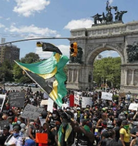 The Jamaican flag was prominent at Brooklyn, New York protest.