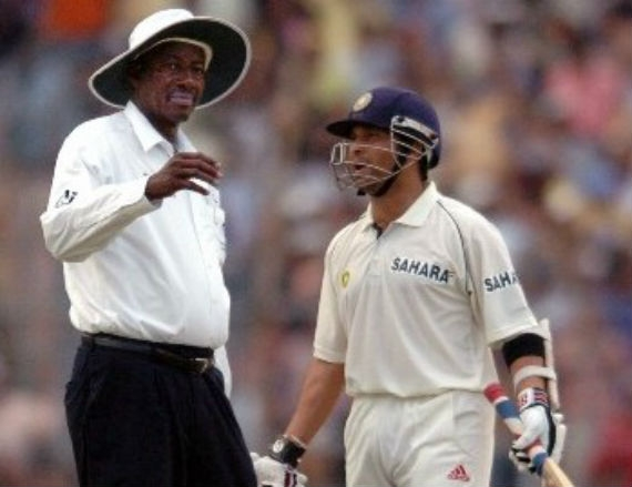 Bucknor, left, listens to Tendulkar during the 2005 Eden Gardens Test.