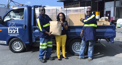 Nadine Jardine, Caribbean Airlines Cargo Operations Manager POS & Southern Caribbean receives donated relief supplies from Kevin Williams and Christian George of The Foundation for the Enhancement and Enrichment of Life (FEEL). The donated supplies will be airlifted to Nassau, Bahamas via Caribbean Airlines scheduled service on Sunday 8 September.