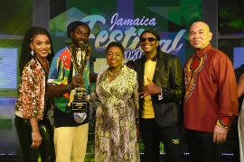 The Minister of Culture, Gender Entertainment and Sport, Honourable Olivia Grange (centre) and Chairman of the Jamaica Festival Song Committee, Orville Hill (far right) stand proudly with the top three winners of the 2020 Jamaica Festival Song Competition at the Competition's Grand Final in July. The winners are Jamaican Reggae icon Buju Banton (left) who won the competition with his entry I am a Jamaican, Dancehall and Reggae veteran Papa Michigan (right) who placed second with Jamaica Dance and actress and musical newcomer and one of the competition's only two female finalists Sakina Deer, who placed third with We are Jamaica. The competition took on a virtual edge this year due to challenges raised by the Covid-19 Pandemic.