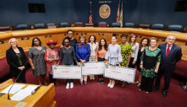 County Commission Chairwoman Audrey Edmonson, Vice Chairwoman Rebeca Sosa, Commissioner Eileen Higgins, and Commissioner Esteban Bovo, Jr., along with Commission for Women members, present the Young Women Achiever scholarship checks.  (Photo by Ryan Holloway/Miami-Dade County)
