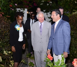 From Left to Right: Bernadette George-Martial, Acting Chief of Protocol; His Royal Highness, Prince Charles, the Prince of Wales; and Zachary Frangos, General Manager, Coconut Bay Beach Resort & Spa escorting Prince Charles to his Suite at Serenity at Coconut Bay